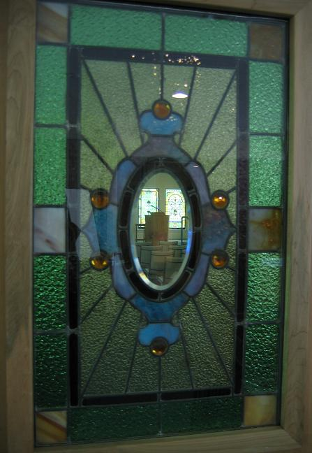 small stained glass windows installed in doors