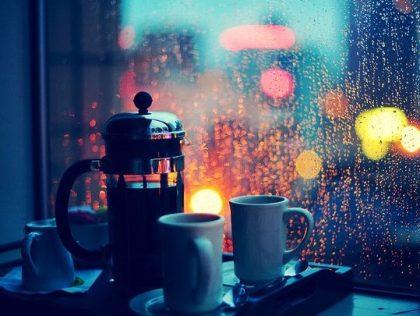 coffee cups and rainy window at night