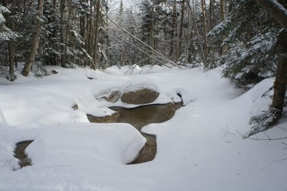 snowy river with melted snow in shape of chalice