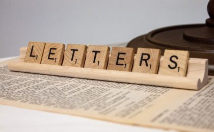 "scrabble tiles spelling the word ""letters"""