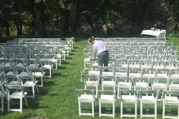 back yard of church with many chairs set up for event