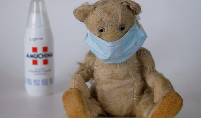 Teddy bear wearing a surgical mask