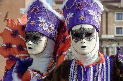 people wearing masks in carnival