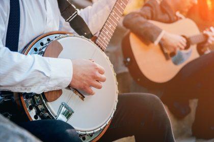men playing banjo and guitar