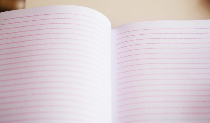 A new ruled notebook lies open, ready for creative output.