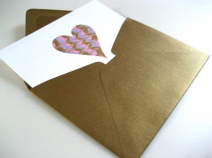 greeting card with heart, halfway in an envelope