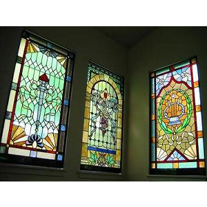three stained glass windows in the sanctuary