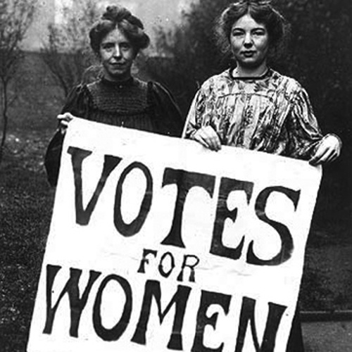 Two women holding a votes for women sign